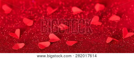 Valentine's Day. Many Red Hearts On Background Of Shining Crystals