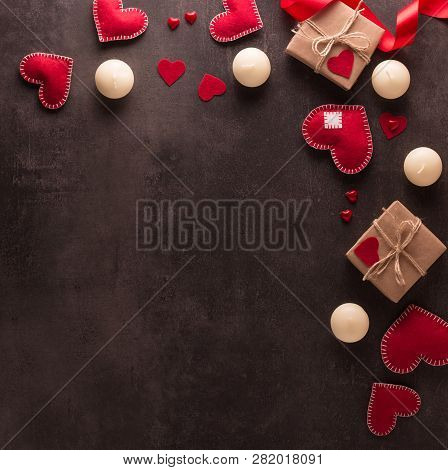Valentine's Day Concept. Candles, Red Hearts, Handmade Gifts On A Dark Background