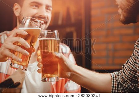 Party In Pub, Clinking Glasses Of Beer, Funny Friends Laugh.