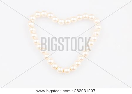 Pearls Necklace In Heart Jewel In White Background