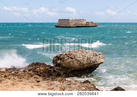 Sao Lourenco Blockhouse. San Lorenzo Island And Fort Nearby Rocky Shore And Coastline Of Mozambique