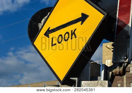 Look Both Ways Sign At A Light Rail Station, Prevents Train, Car And Pedestrain Accidents
