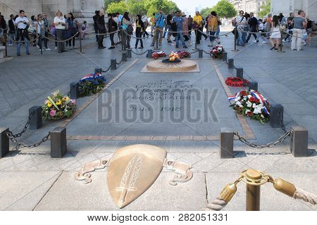 Paris, France, June 20: Residents And Visitors Of The City At The Tomb Of The Unknown Soldier Near T