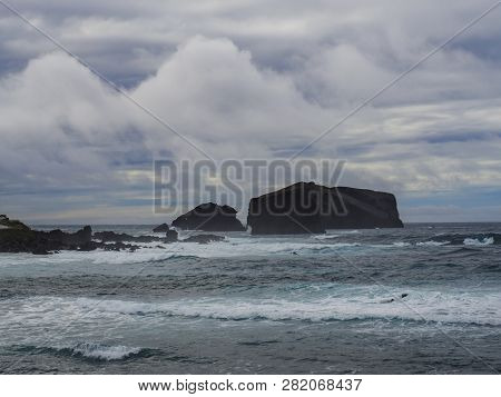 Volcanic Rock Cliffs And Stone Formation At Mosteiros Village, Rough Sea Waves. Sao Miguel Island, A
