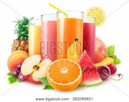 Isolated Juices. Glasses Of Fresh Juice And Pile Of Fruits And Berries Isolated On White Background