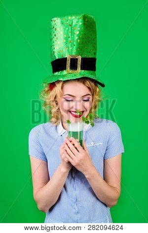 Patrick. Saint Patrick's Day. Woman In Top Hat Holds Glass With Beer. St Patricks Day. Leprechaun. G
