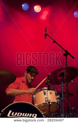 CLARK, NJ - SEPTEMBER 11: Drummer / Percussionist Dan Konopka of the band OK Go performs at the Union County Music Fest on September 11, 2010 in Clark, NJ.