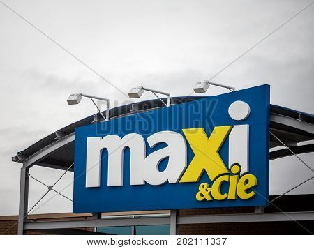 Montreal, Canada - November 9, 2018: Entrance Of A Maxi & Cie Supermarket With Its Logo. Belonging T