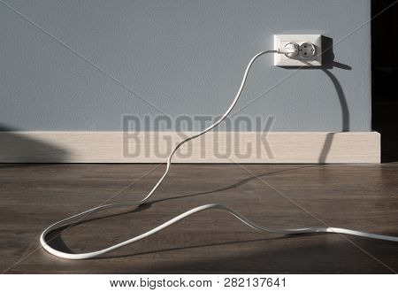 Power Cord Cable Plugged Into Wall Outlet