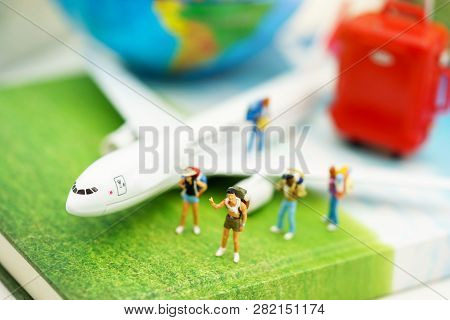 Miniature People: Traveller With Backpack Walking On The Path Of Tourism By Airplane. Travel, Explor