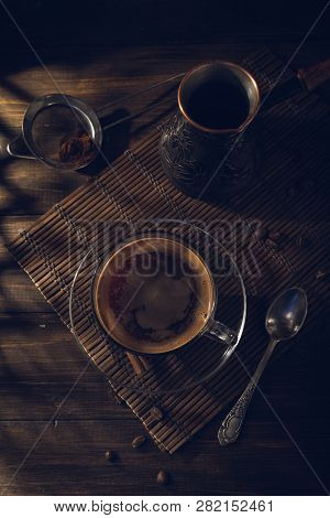 Cup Of Black Coffee On The Table With Cream