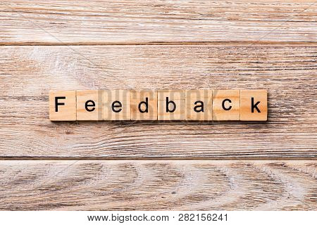 Feedback Word Written On Wood Block. Feedback Text On Wooden Table For Your Desing, Concept