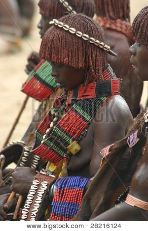 A  Hamer girl of Ethiopia wears traditional jewelry for a wedding