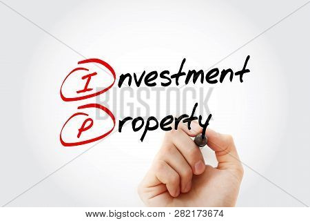 Ip - Investment Property Acronym With Marker, Business Concept Background