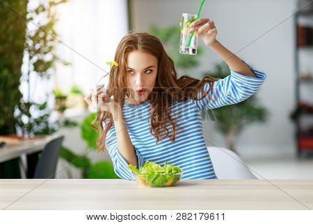 Healthy Eating. Happy Young Girl Eating Salad In The Morning In Kitchen