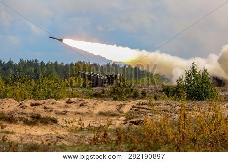 Rocket Launcher With Himars. Nato Soldiers And Military Equipment In Latvia. International Military