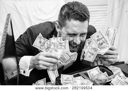 Portrait Of A Happy Young Businessman Throwing Money Banknotes. Businessman With Money On Office Roo