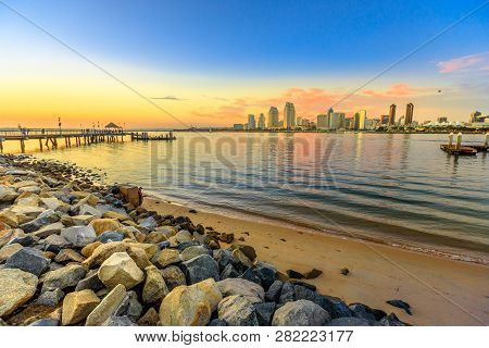 Scenic Sunset On San Diego Bay From Old Wooden Pier In Coronado Island, California. People And Touri