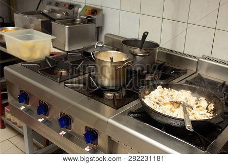 Oily And Dirty Gas Stove In The Kitchen At The Restaurant Catering, Anti-sanitary, Unsanitary Condit