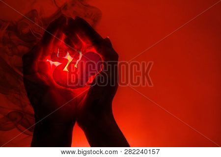 Silhouette Of Female Hands And Application In The Form Of An Embryo.the Concept Of Abortion . Hands