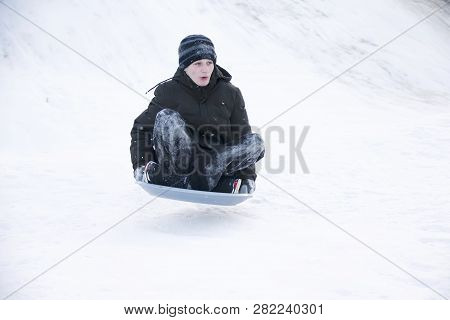 Belarus, The City Of Gomel, January 07, 2018.central Park.sledding Off A Snow Slide.driving On The I