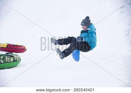Belarus, The City Of Gomel, January 07, 2018.central Park.sledding Off A Snow Slide.a Boy Sledding J
