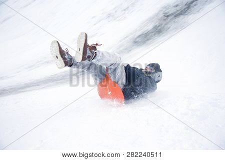Belarus, The City Of Gomel, January 07, 2018.central Park.sledding Off A Snow Slide.ride On Ice-boat