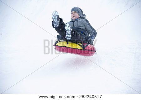 Belarus, The City Of Gomel, January 07, 2018.central Park.child Sledding Cheesecake.sledding Off A S