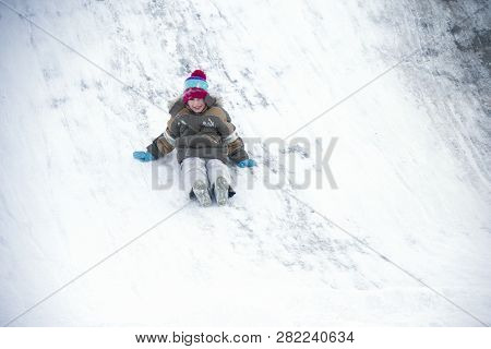 The Boy Drives Off A Snow Slide