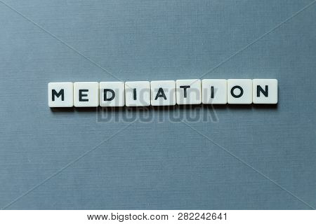 Business And Finance Concept. Mediation Letter On Grey Background.