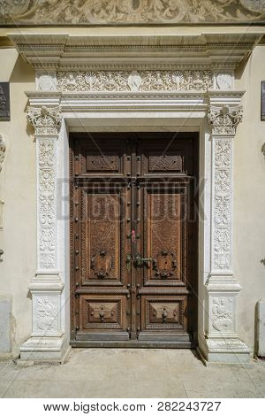 one of the Door of the Peles castle and ornamental garden in Sinaia landmark of Carpathian mountains poster