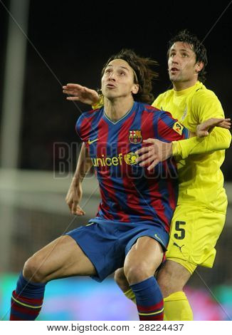 BARCELONA - JAN 2: FC Barcelona player  Ibrahimovic (L) with Capdevila (R) of Villarreal during Spanish league match at the Nou Camp Stadium on January 2, 2010 in Barcelona, Spain.
