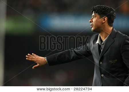 BARCELONA - APR 19: Frank Rijkaard coach of Barcelona in action during a Spanish League match between FC Barcelona and Espanyol at the Nou Camp Stadium on April 19, 2008 in Barcelona, Spain