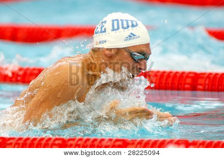 BARCELONA, SPAIN - JUNE 9: French olympic medalist swimmer Hugues Duboscq swims breaststroke style during the Mare Nostrum meeting in Barcelona's Sant Andreu Club, June 9, 2010 in Barcelona, Spain.
