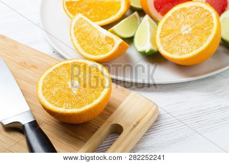Fresh Citrus Fruits On White Wooden Table