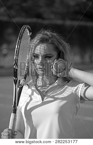 Woman Hold Racket And Ball On Lawn. Sensual Woman On Tennis Court. Tennis Player Training On Sunny O
