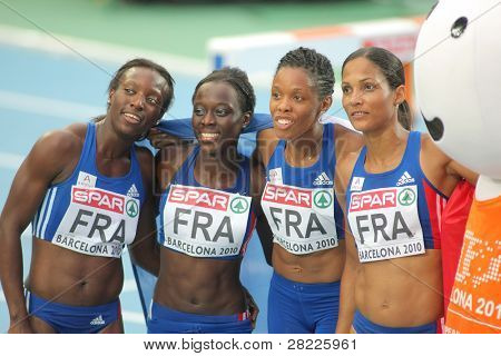 BARCELONA, SPAIN - AUG 01: Mang, Soumare, Jacques-Sebastien and Arron of France celebrate silver of 4X100 Relay on the 20th Euro Athletics at the Olympic St on August 1, 2010 in Barcelona, Spain