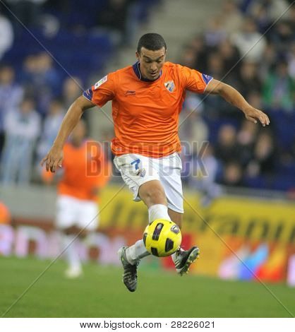 BARCELONA - NOV 6: Nabil Baha of Malaga in action during Spanish League match between Espanyol and Malaga CF at the Estadi Cornella on November 6, 2010 in Barcelona, Spain