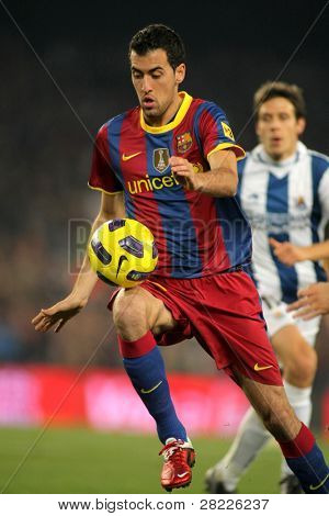 BARCELONA - DEC 12: Sergio Busquets of Barcelona in action during a Spanish League match between FC Barcelona and Real Sociedad at the Nou Camp Stadium on December 12, 2010 in Barcelona, Spain