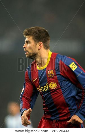 BARCELONA - JAN 16: Gerard Pique of Barcelona during the match between FC Barcelona and Malaga CF at the Nou Camp Stadium on January 16, 2011 in Barcelona, Spain