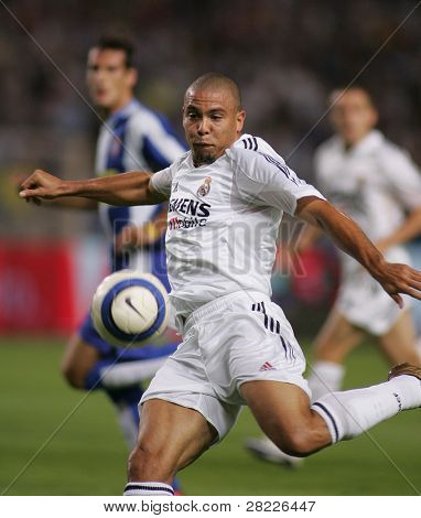 BARCELONA - SEPT 18: Brazilian player Ronaldo of Real Madrid in action during the match between Espanyol and Real Madrid at the Stadium on September 18, 2004 in Barcelona, Spain