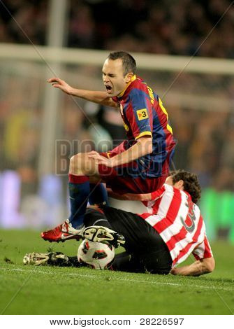 BARCELONA - FEB 20: Andres Iniesta of Barcelona in action during the match between FC Barcelona and Athletic de Bilbao at the Nou Camp Stadium on February 20, 2011 in Barcelona, Spain