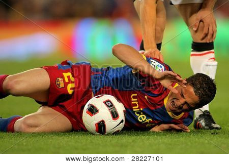 BARCELONA - APRIL 23: Ibrahim Afellay of Barcelona injured during the match between FC Barcelona and Osasuna at the Nou Camp Stadium on April 23, 2011 in Barcelona, Spain