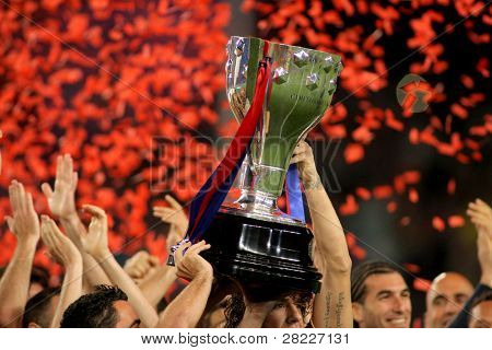 BARCELONA - MAY 15: FC Barcelona's players hold up La Liga trophy after the match between Barcelona and Deportivo La Coruna at Camp Nou Stadium on May 15, 2011 in Barcelona, Spain