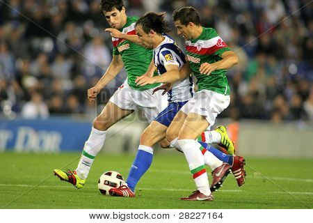 BARCELONA -MAY 2: Verdu(C) of Espanyol fight with Ekiza(R) and Javi Martinez(L) of Bilbao during a match between Espanyol and Athletic Bilbao at the Estadi Cornella on May 2, 2011 in Barcelona, Spain