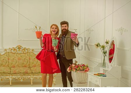 Florist Concept. Happy Woman And Man Florists Smile With Spring Flowers. Florist Shop. Florists In F