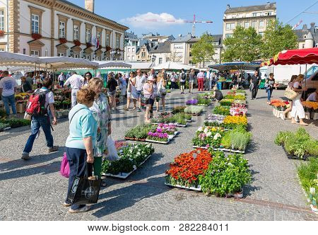 Luxembourg City, Luxembourg - August 18, 2018: Flower Market With Shopping People In Luxembourg City
