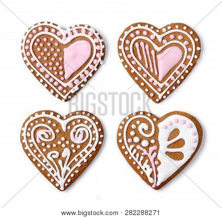 Homemade Gingerbread Heart Shaped Cookies With Sugar Icing Decoration, On White Background Isolated