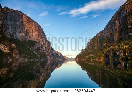 Morning sky over calm Lysefjord (Lysefjorden) as viewed from Lysebotn village at the end of the fjord in Forsand municipality of Rogaland county, Norway, Scandinavia