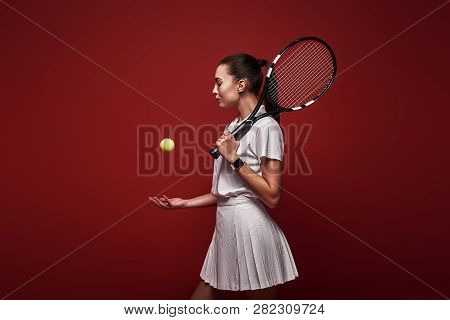 Talk With Your Raquet, Play With Your Heart. Young Tennis Player Standing Isolated Over Red Backgrou